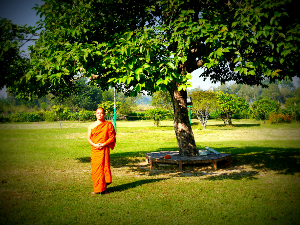 small monk standing